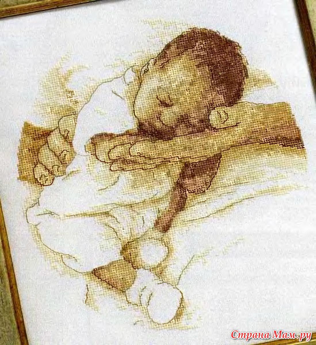 Вышивка младенец на ладонях