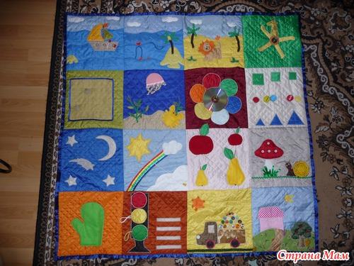 Развивающий коврик для ребенка до года фото
