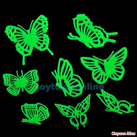 Светящиеся бабочки на стене