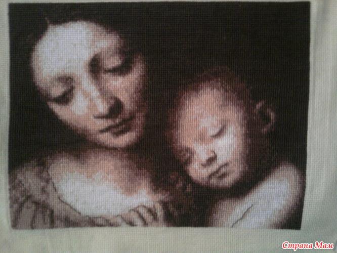 малыша на черной канве и