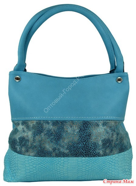 Пристрой женской сумки из экокожи.
